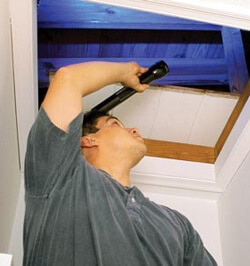 man inspecting his own home